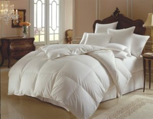 comfortable-pillows-and-white-luxury-bedding-coverlet-with-pretty-wooden-headboard-and-drawers-for-master-bedroom-decor-with-sleek-ceramic-floor-luxury-bed-with-lots-of-pillows